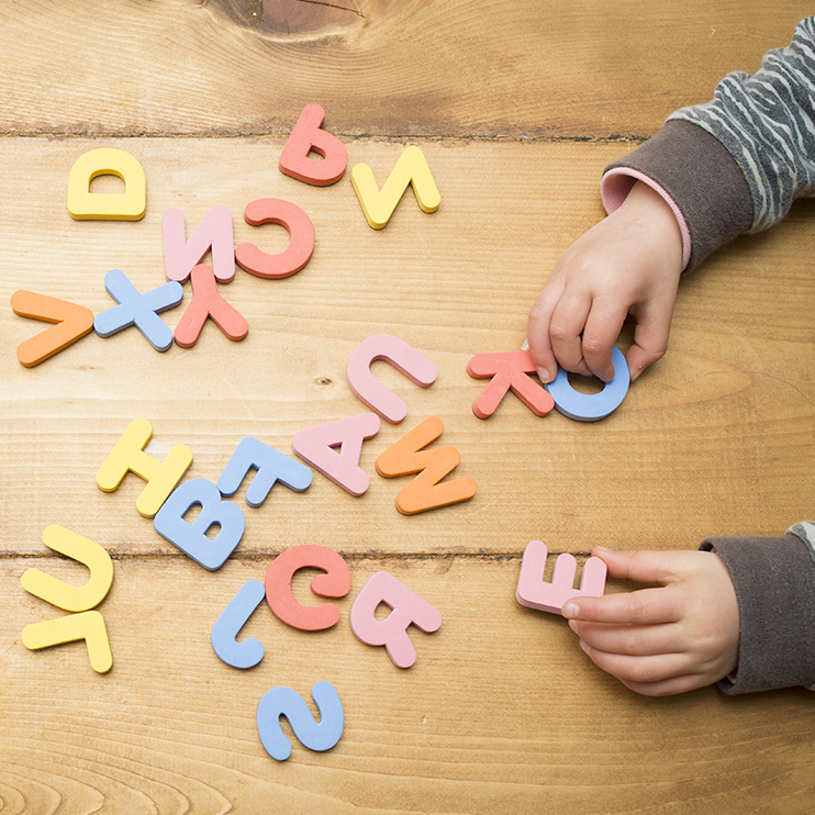 Child playing with Foam Alphabet Pieces